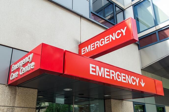 "Light boxes attached to building read, ""Emergency"", and ""Emergency Care Centre""."
